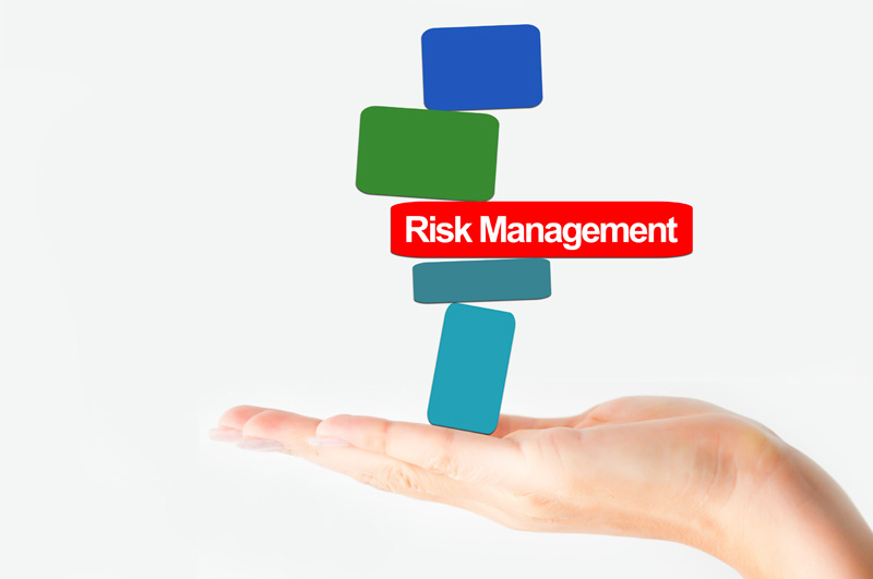 open palm holding blocks with risk management in middle